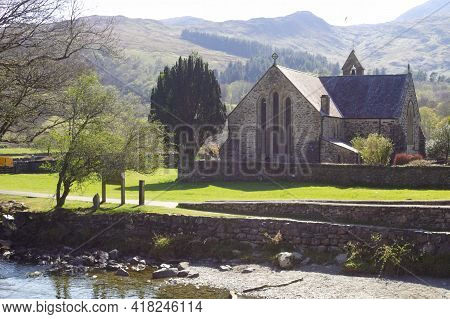 Beddgelert, Snowdonia, Wales Old Church Of Saint Mary Standing By The River Glaslyn Beautiful Landsc