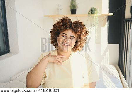 Beautiful Happy Curvy Plus Size African Black Woman Afro Hair Posing In Beige T-shirt And Underwear