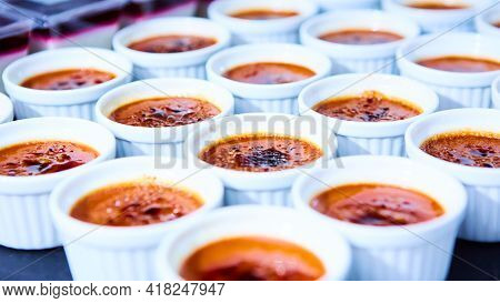 Rows Of Creme Brulee. Traditional French Vanilla Cream Dessert With Caramelised Sugar On Top. Shallo