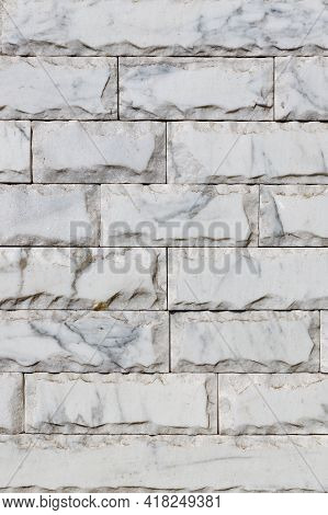 The Texture Of A Wall Covered With Gray Marble Tiles With Chips Around The Perimeter, Brown Veins On