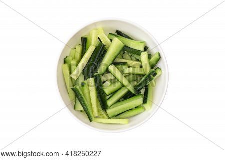 Sliced Cucumber In A Plate On A White Background. Fresh Cucumber Sliced Into Pieces Close-up.