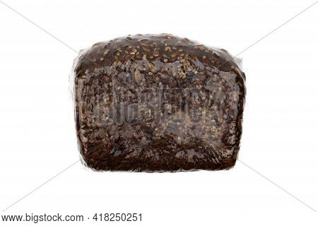 Bread In Plastic Packaging On A White Background. Vacuum Packed Rye Bread Close-up.