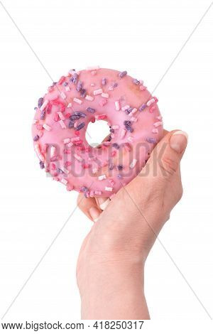 Donut Close-up In Hand On A White Background. Round Donut Isolated On White Background.