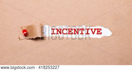 Beneath The Torn Strip Of Kraft Paper Attached With A Red Button Is A White Paper Labeled Incentive