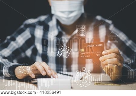 Credit Card Debt From Covid-19 Concept, Asian Men Use The Hand To Hold The Credit Cards From Bank De