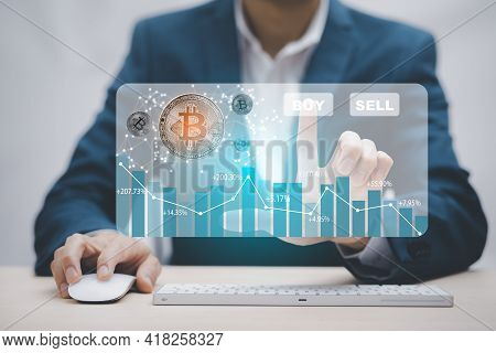 Digital Graph With Bitcoin Chart On-screen Among Piles Of Bitcoin Concept. Businessman Touch On  Buy