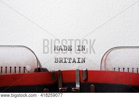 The sentence, made in Britain, written with a typewriter.