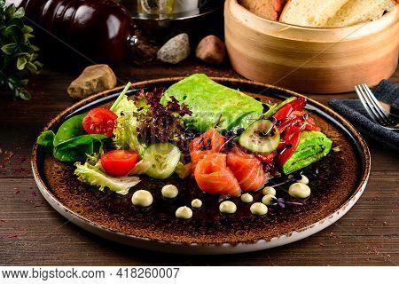 Breakfast. Omelette With Green Arugula And Salmon. Frittata - Italian Omelet