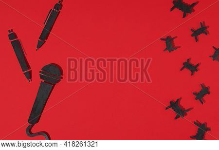 World Press Freedom Day Concept. 3 May. A Black Microphone And A Pen Made Of Paper, As A Symbol Of F