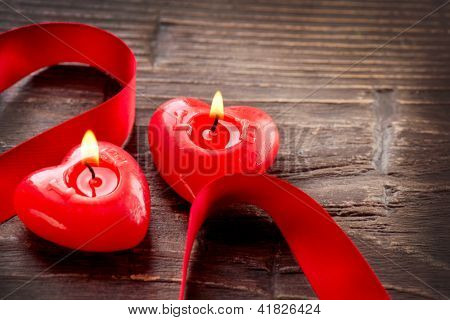 Valentines Hearts Candles Border Design over Wood. Red Burning Heart Shaped Candle Over Wooden Background. Valentine. Valentine's Day