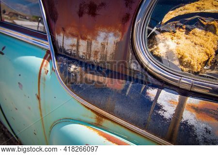 Exterior Detail Of A Junked Vintage Retro Vehicle In A Junkyard.