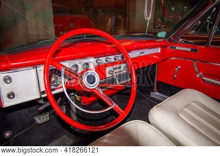 Interior Of A Junked Retro Vehicle With A Dirty Dash Board In A Junk Yard.