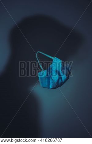 Protection Against Coronavirus Infection Covid-19. Silhouette Of Men With A Medical Mask For Protect