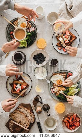 People Having Brunch Together And Talking, Top View