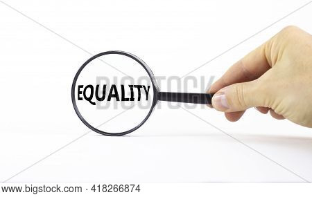 Equality And Inclusion Symbol. Magnifying Glass With Word Equality On A Beautiful White Background.