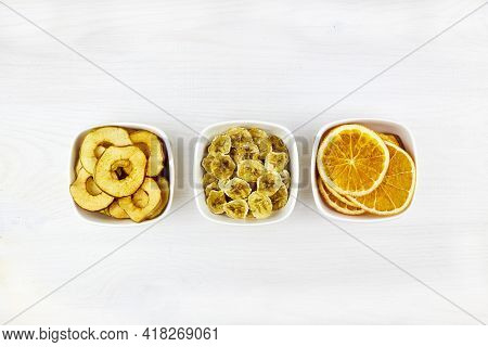 Dried Fruit Slices: Orange, Apple, Banana On A Bowls. Dehydrated Crispy Slices, Fruit Chips. Healthy