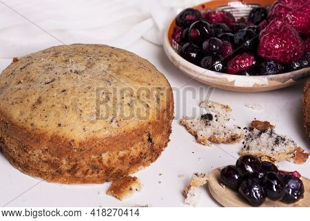 Tasty Homemade Cake And Berries On Plate, White Background. Homemade Food Concept