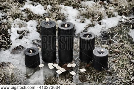 Grunge Wicca Ritual With Nurning Black Candles And Runes Outside In Winter.  Esoteric, Gothic And Oc