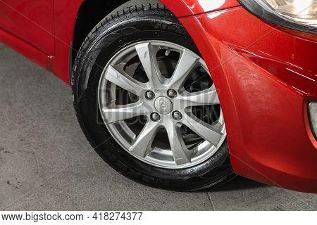 Novosibirsk, Russia - April 25 2021: Hyundai Solaris, Close-up Of The Bumper, Alloy Wheel, Car Detai
