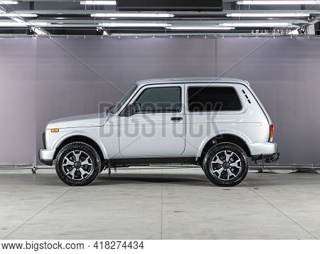 Novosibirsk, Russia - April 25 2021:  White Jeep Lada  Niva 4x4 , Side View. Photography Of A Modern