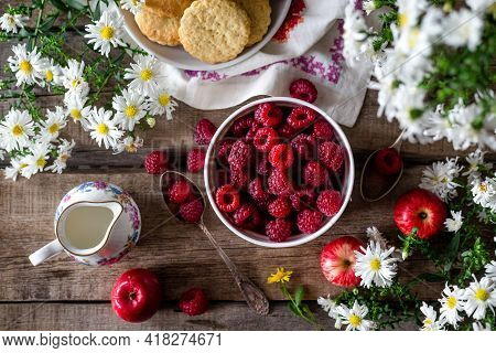 Sauce Of Wild Organic Cranberries On A Wooden Table With Berries And Pine Branches On A Live Cut Dow