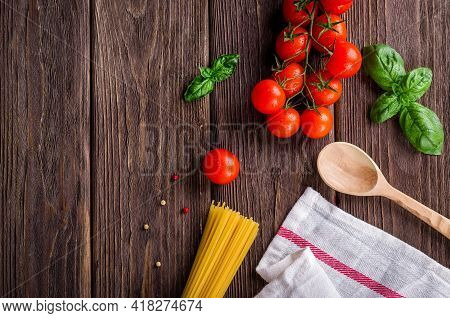 Fresh Organic Tomatoes In White Plate Isolated On Wooden Table