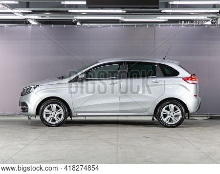 Novosibirsk, Russia - April 25 2021:silver Lada Xray, Side View. Photography Of A Modern Car On A Pa