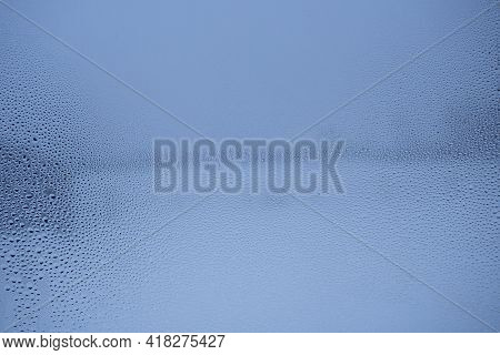 Wet, Misted Window. Wet Glass Surface Texture. Glass In Drops Of Rain.