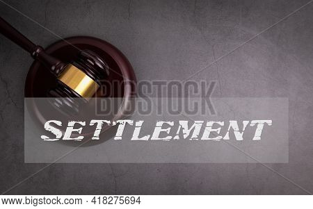 Settlement. Conflict, Dispute And Mediation Process. Judges Hammer On A Concrete Background
