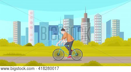 Guy Riding In Park Summertime. Man Rides Bicycle On City Road Spends Time In Town With Modern Buildi