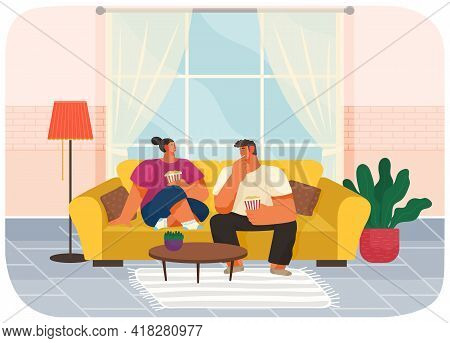 Couple Sitting On Couch At Home In Living Room Interior Near Big Window, Eating Popcorn And Talking.