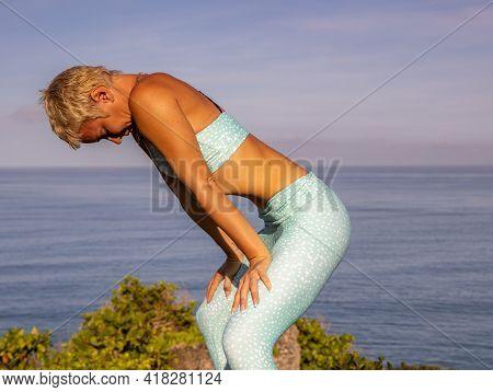 Yoga Concept. Slim Woman Practicing Uddiyana Bandha, Abdominal Lock Or Upward Lifting Lock. Hatha Yo