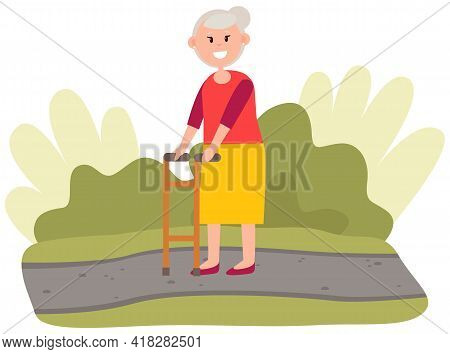 Elderly Woman Moving With Help Of Front-wheeled Walker In City Park. Disabled Lady Is Spending Time