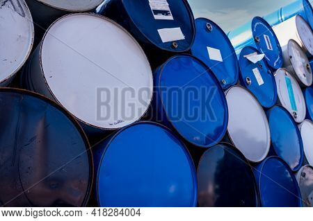 Closeup Old Chemical Barrels. Blue And White Oil Drum. Steel Oil Tank. Toxic Waste Warehouse. Hazard