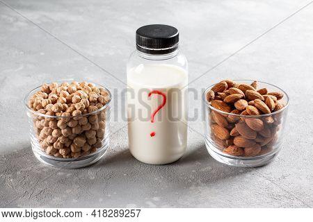 Alternative Types Of Milks. Chickpea Or Almond Milk? Non Dairy Milk. Vegan Food Concept.