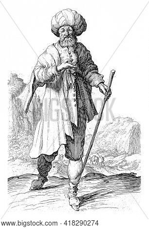 A man in oriental clothing with a turban on his head and a walking stick in his hand. In the background a hilly landscape and a number of figures.