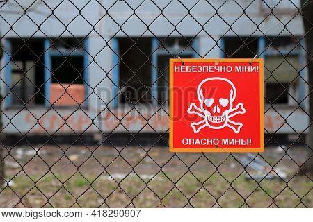 Armed Conflict East Of Ukraine, Ukrainian War. Red Sign With Skull And Crossbones, Inscription In Uk