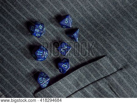 Image Of A Set Of Blue Rpg Dice On A Pinstripe Vest With A Pocket