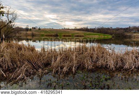 Nice evening scene on wild lake in spring evening. Take it in Ukraine