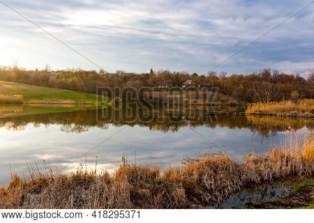 quiet sunset over vollage lake at spring time