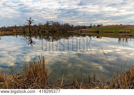 quiet evening landscape on wild rural lake at spring time