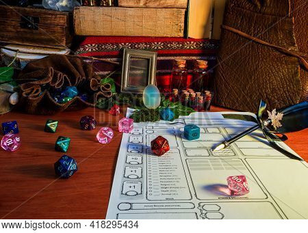 Rpg Tabletop Game Attributes, Like Polyhedral Dice, Dice Bag And Potion, On A Wooden Table In Warm L