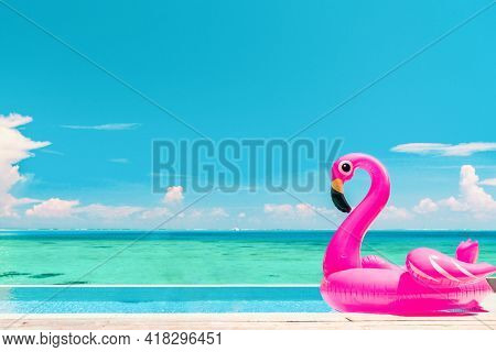 Travel Vacation Pool Beach travel concept with inflatable pink flamingo float toy mattress in luxury swimming pool. Luxury lifestyle summer holidays travel background