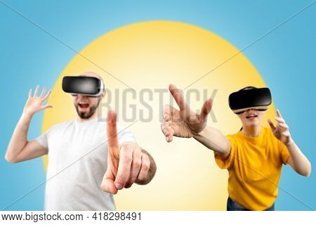People Wearing Virtual Reality Glasses Reach For A Virtual Object With Their Hands. Blurred. Blue Ba