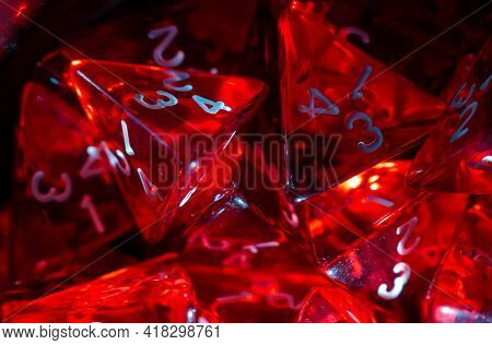 Close-up Of Many Red Four Sided Dice Used For Role Playing Games