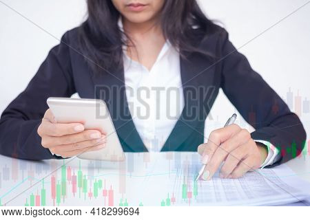 Staff Business Woman With Black Suit Holding Mobile And Check Data With Charts Stockmarket And Grahp