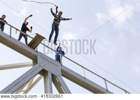 03 June 2018 Belarus. Gomil. Rope Jumping. People Jumping From A Bridge On A Rope. Extreme Sports.