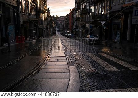 PORTO, PORTUGAL - APR 25, 2021: Empty streets Porto. After many months of quarantine imposed in connection with covid-19 coronavirus pandemic, Portugal is gradually beginning to lift restrictions.