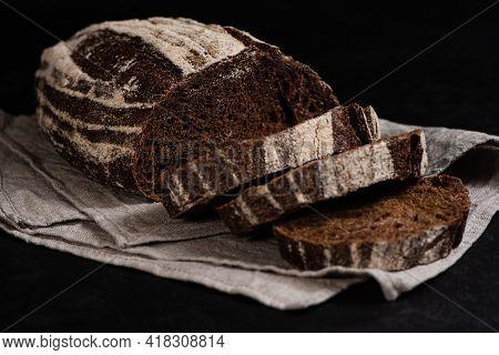 Artisan Sliced Rye Bread. Closeup Of Slices Of Freshly Baked Sourdough Bread On Dark Background. Low