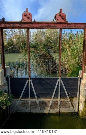 Wooden Doors In An Irrigation Ditch, To Control The Entry And Exit Of Water